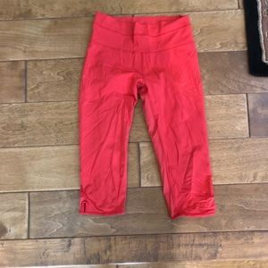 Lululemon coral red cropped leggings with key hole